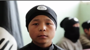 Uighur child soldiers fighting for ISIL in Syria. The CIA sees him as a future terrorist fighting against Chinese forces on the streets of Urumchi, the capital of the Xinjiang-Uighur Autonomous Republic.